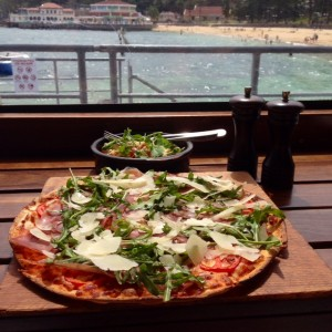 Prosciutto Pizza - sliced prosciutto, rocket, tomato, Parmesan & balsamic dressing